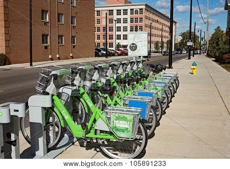 DAYTON, OHIO, USA-OCTOBER 18: Green Link bicycles stand in early morning light near University of Dayton waiting to be rented as part of Link: Dayton Bike Share program, Dayton, Ohio,October 18, 2015.