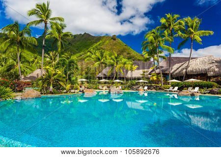 Swimming pool and houses of tropical resort on Moorea, Tahiti