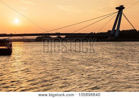 Snp Bridge Across Danube River At Yellow Dawn