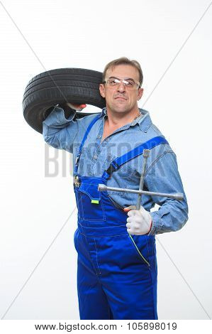 adult male mechanic with a wrench and tire in the goggles poster