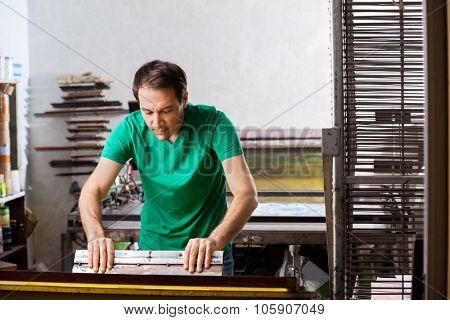 Silkscreen artist in atelier creating artwork