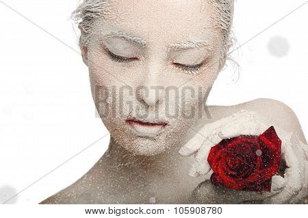 Frozen Woman In Snow And With Rose His Hands