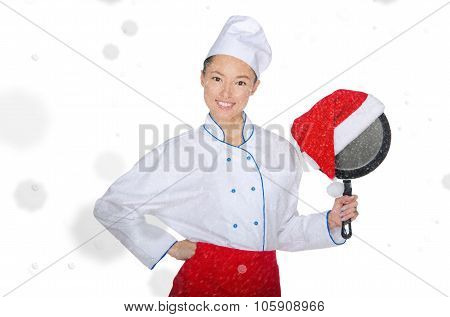 Happy Asian Chef With Frying Pan And Christmas Hat