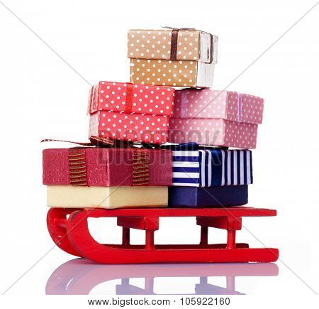 Red sled full of gift boxes, isolated on white background