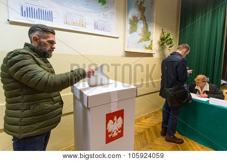 KRAKOW, POLAND - OCTOBER 25, 2015: Unidentified voter at the polling station during polish parliamentary elections to both the Sejm and Senate.