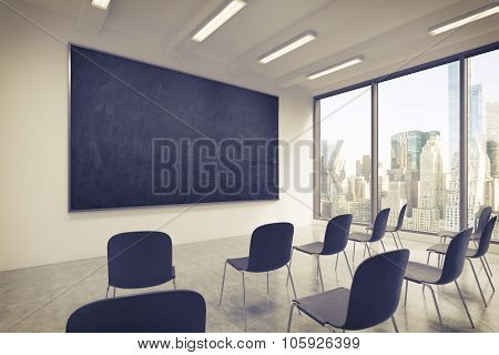 A Classroom Or Presentation Room In A Modern University Or Fancy Office. Black Chairs, A Black Chalk