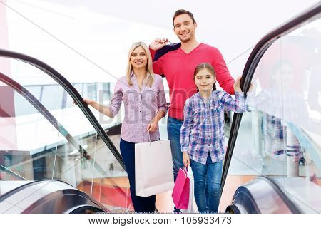 Loving family using escalator