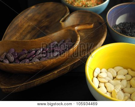 Heart shaped wooden bowl and bean shaped bowl with beans