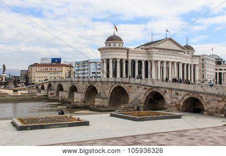 Skopje, Macedonia - April 3 2014: Macedonian archaeological museum in Skopje and Stone bridge Macedo