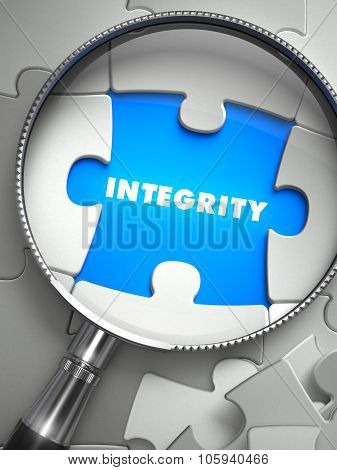 Integrity - Missing Puzzle Piece through Magnifier.