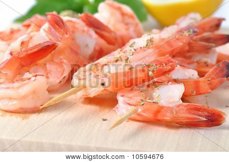 Shrimps, Lemon, And Basil On Board Isolated On White Background