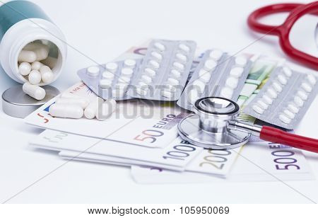 Pills stethoscope and money