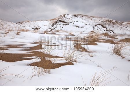 Sand dunes in winter with snow