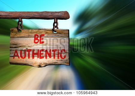 Be authentic sign on old wood with blurred background poster