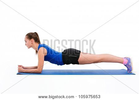 Portrait of a fitness woman doing plank exerises isolated on a white background