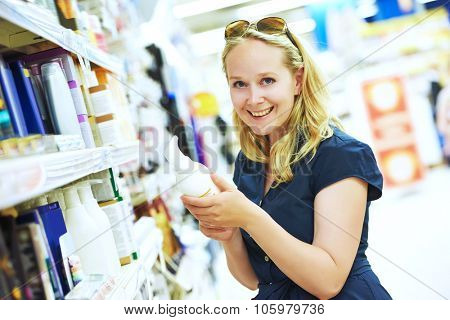 Shopping. Woman choosing skin care cosmetic cream products in beauty store or supermarket. shallow DOF