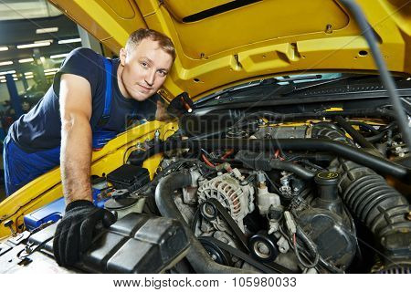 auto mechanic repairman tighten screw with spanner during automobile car maintenance at engine repair service station garage poster