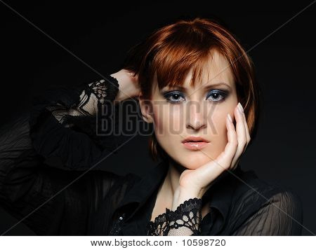 Beauty Portrait Of Pretty Woman With Short Fashion Bob Hairstyle And Dark Make-up. Black Background