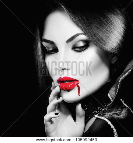 Vampire Halloween Woman portrait. Beauty Sexy Vampire Girl with  bripping blood on her mouth. Fashion Art design. Black and White photo of Attractive model girl in Halloween costume and make up