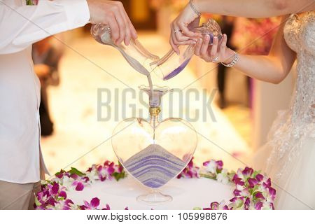 Blending Of The Sands At Wedding Ceremony
