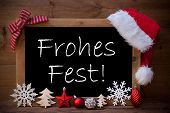 Blackboard With Red Santa Hat And Christmas Decoration like Snowflake, Tree, Christmas Ball, Fir Cone, Star. German Text Frohes Fest Means Merry Christmas. Brown Wooden Background poster