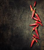 Vibrant red mexican hot chilli pepper on old background poster