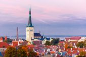 Aerial cityscape with Medieval Old Town and St. Olaf Baptist Church in Tallinn in autumn evening, Estonia poster
