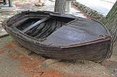 Small Wooden Dinghy Boat Wreck at Shore poster