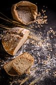 A freshly baked homemade loaf of wheat sourdough bread sliced poster