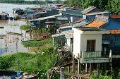 HONG NGU- VIET NAM- OCT 15: Residential on water group of floating house of poor people on Mekong Delta river precarious life danger home from sheet metal Hongngu Vietnam Oct 15 2015 poster