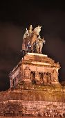 Statue of imperator Wilhelm at the Deutsches Eck in Koblenz at night poster