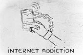 hand chained to a beeping mobile phone concept of internet addiction poster