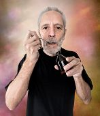 A mature man is drinking a spoon of cough syrup to cure his sore throat and bronchitis poster