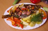 baked fish flounder with vegetable and bacon poster