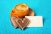 ceramic cup with coffee espresso tablet for text and two chocolate marzipan candy hearts on a bright blue background love concept have a nice day good morning good day happy Valentine's Day poster