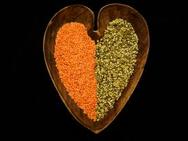 Lentils in a heart shaped wooden bowl