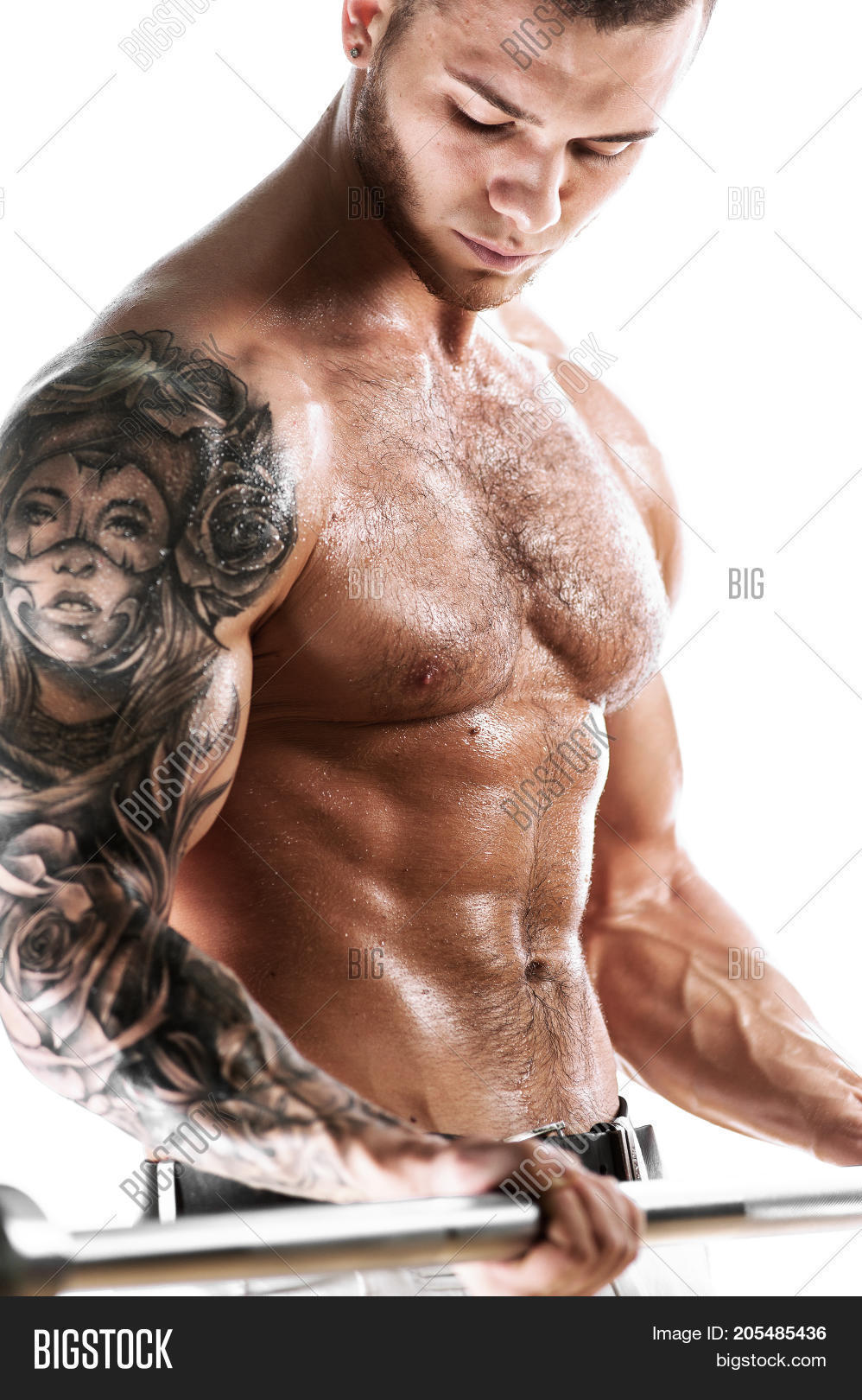 678459d7d2 Muscular sexy fitness model posing shirtless over white background. Studio  shot of Athletic young man