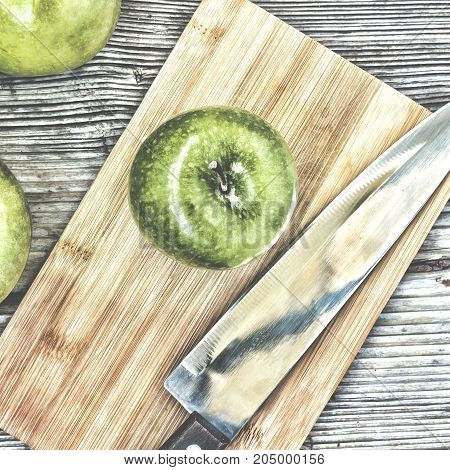 Green Apples On A Kitchen Wooden Table.