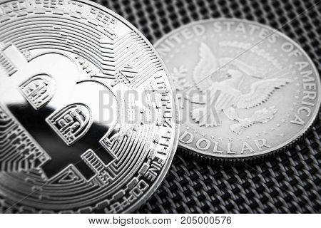 Bitcoin and half dollar coins. Black and white photo