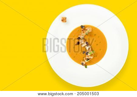 Vegetable soup with toast bread on yellow background