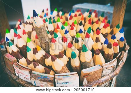 One of the pencils selected among the heap of others. Business concept in choosing ideal person from many candidates. Selective focus. Vintage style