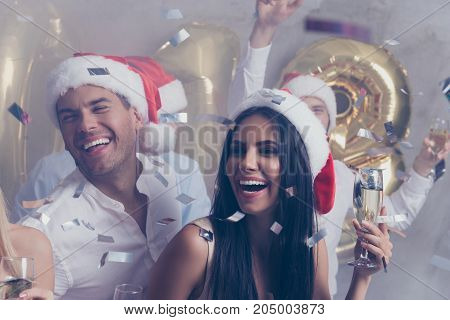 Celebrating newyear. Closeup cropped beautiful festive youth in love with stemware of martini on luxury feast many glitters is in air classy outfits so glamorous and fancy! Chilling relax mood
