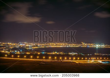 Bay of the night Gelendzhik, view from the Thin Cape, night resort town, reflection of night lights