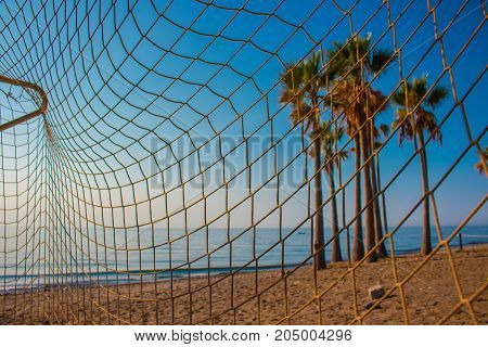 Beach. Football net on the beach. Costa del Sol, Andalusia, Spain.