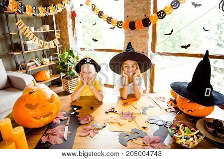 Portrait Of Two Small Kids At Home, Prepared For Creepy Carnival - Blond Small Witch And Pirate, Bon