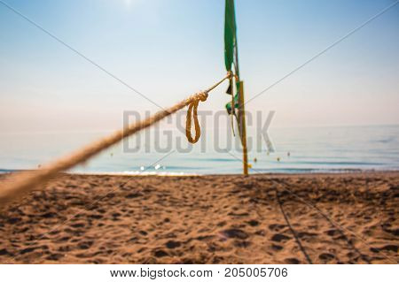 Beach view. Volleyball net on the beach. Costa del Sol, Andalusia, Spain.