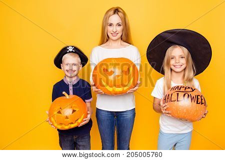 Ready For The October Feast! Blonde Mother With Two Small Cheerful Kids, Girl Is A Fairy, Boy Is A P