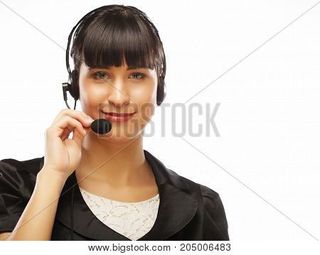 Female customer support operator with headset and smiling, close up