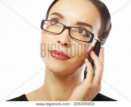 Young business woman with mobile phone over white background
