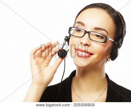 Portrait of smiling customer support female phone worker, over white  background. Consulting and assistance service call center.Close up picture.